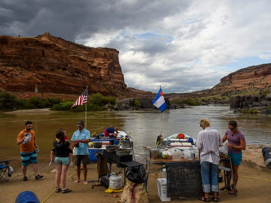 A group with Adventure Bound River Expeditions gets ready for the second day of rafting down the Colorado River, exploring Ruby and Horsethief Canyons.