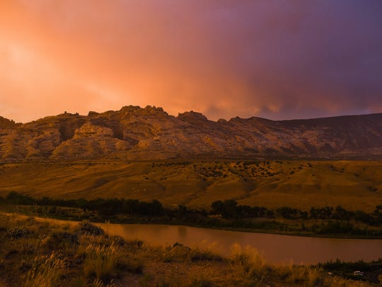 The sun begins to set in Dinosaur National Monument Monday, July 13, 2015, in Jensen, UT.