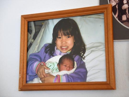 Bella Cordova holding her baby sister Ariana Cordova.