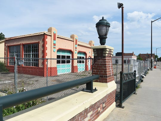Three blocks of downtown Loveland are fenced off for construction on the South Catalyst Project on Wednesday. The project involves razing nearly three city blocks to clear the way for a new development including a parking garage, apartments, condos, movie theater, offices and retail.