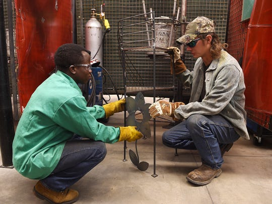 Guy Seguele, left, works on a project in welding class with Jacob Grudle at Front Range Community College on Monday, September 19, 2016. Seguele survived a civil war in Africa and is a First Class scholar.