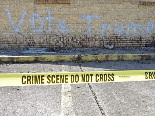 Police tape surrounds the burned and vandalized Hopewell