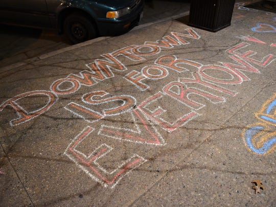 Sidewalk is chalked with a message opposing a proposal that would prohibit sitting and lying down in Old Town outside The Armory during the annual State of the City address on Monday, January 30, 2017.