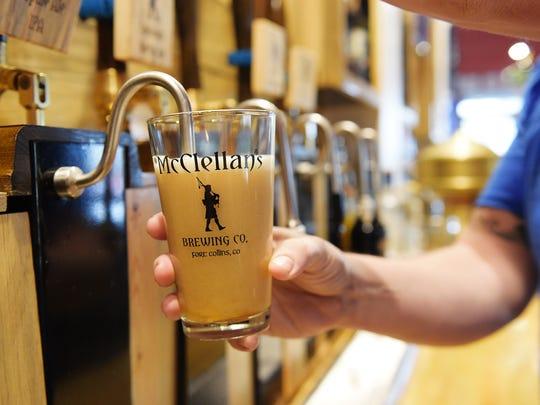 Scottish brewer Graeme Hirstwood pours an IPA at McCllelan's