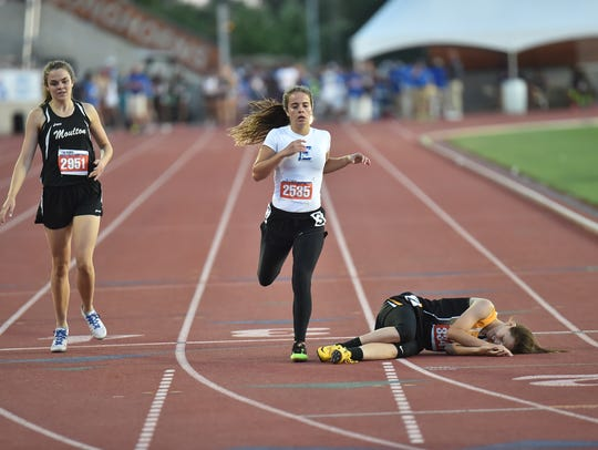 Eden's Dustee Hoelscher runs in the 400 meters Friday,