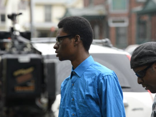 Josiah Leach, center, of South Burlington, arrives at U.S. District Court in Burlington on Friday, May 26, 2017, accompanied by his step brother, LeonMcKenzie. Leach, accused of making death threats against South Burlington High School teachers and students in April, was back in court after prosecutors said he violated his conditions of release,