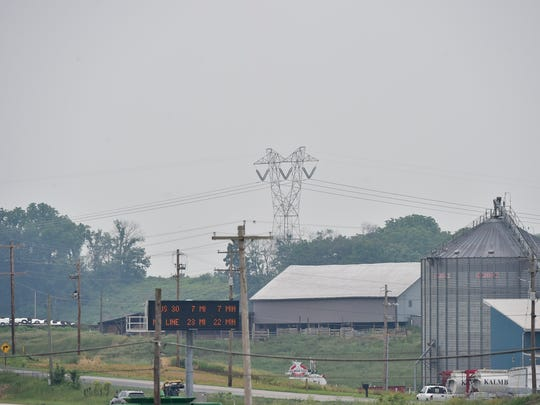 Towers carrying 500 kV power lines are seen off Rice Road in Shippensburg on Monday, June 5, 2017. A plan will connect a new substation in the area to one in Ringgold, Maryland, by a 25-mile long 230 kV line.