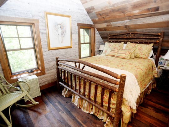 A bedroom on the second floor of Geni McKee's 18-by-20-foot cabin,