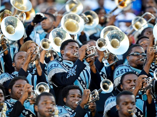 Junior Jamie Gibson, center, plays with the Jackson State Marching Band during the Southern Heritage Classic at the Liberty Bowl on Sept. 14, 2013.
