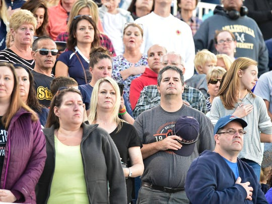 Fans stand for the National Anthem at Trojan Stadium. Chambersburg hosted Central Dauphin East in high school football on Friday, September 29, 2017. The Panthers won 36-26.