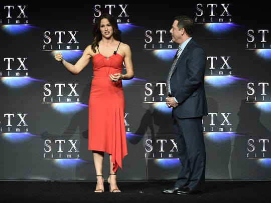 Jennifer Garner and Adam Fogelson speak during STX