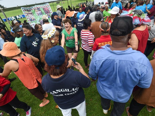 "Manamko' from various senior centers mingle as part of the ""Gathering game"" during the third annual Huegon-Manamko' Senior Games at the Governor Joseph Flores Beach Park in Tumon"