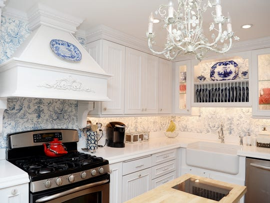 After tearing out some walls, the Parks' new kitchen was designed around Norm's large collection of flow blue antique china. Popular during the Victorian era, the dishes are blue and white. His collection spans 70 years with pieces from 1840 to 1910.
