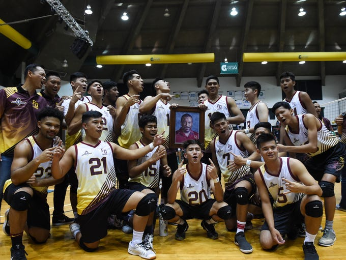 The Father Duenas Friars volleyball team celebrate