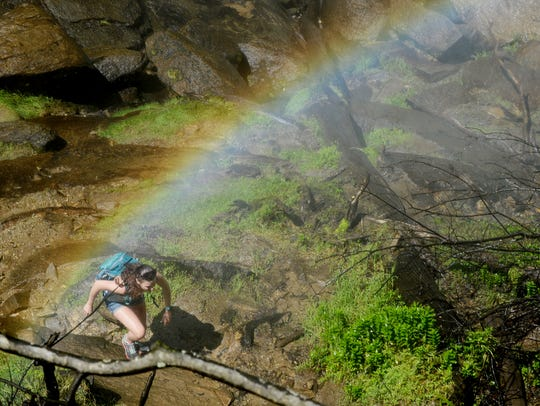 Rachel Bowyer, of Arvada, Colorado, hikes below Rainbow