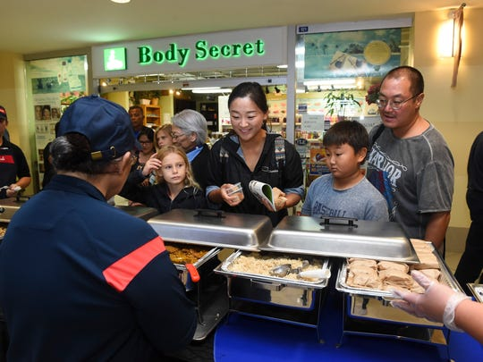 Event goers were treated to samples of free school food by Sodexo employees during the Guam Department of Education 2018 Fourth Annual DOE Fair at Agana Shopping Center in Hagåtña, Aug. 4, 2018.