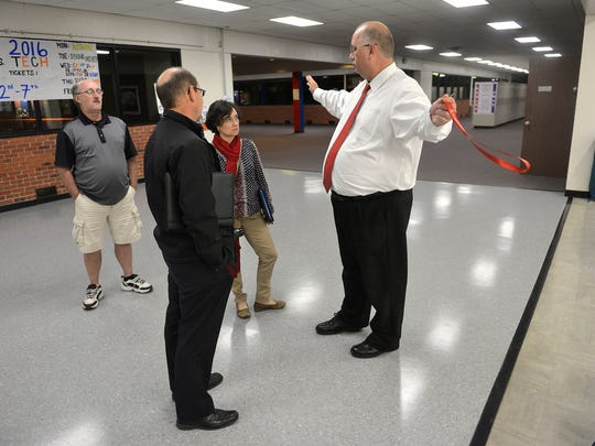 Apollo High School Principal Adam Holm talks Monday, Oct. 3, about plans to reconfigure and enlarge the school's commons and lunch area if the levy passes. Currently, lunch lines are long and there are not enough seats for the students.