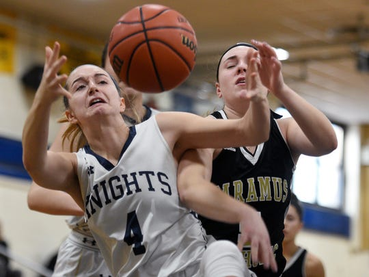Old Tappan's Jackie Kelly #4 grabs a rebound in front of Paramus Catholic's Calla Hughes #5 during Tuesday's game. Old Tappan won their game giving Coach Brian Dunn his 400th victory on Tuesday, February 20, 2018.