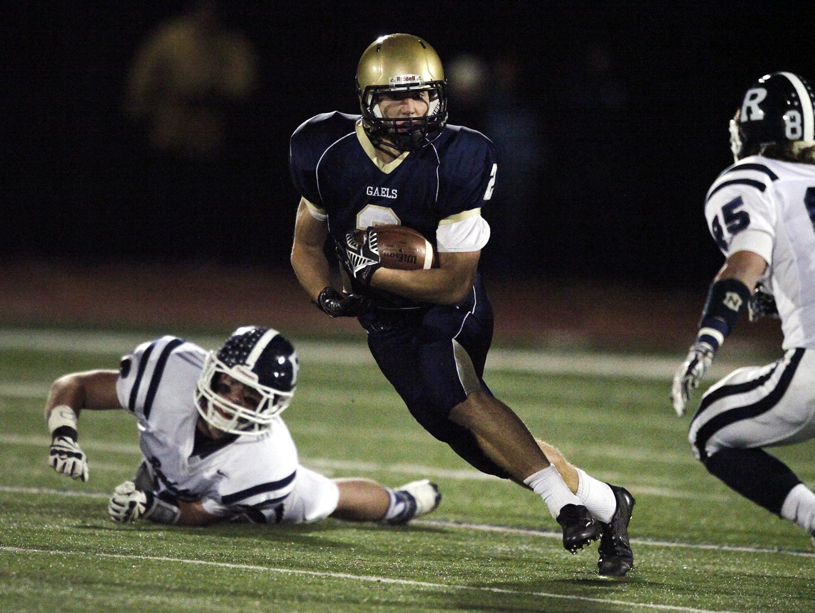 Roxbury's Jack Clevenger (2) tries to run around a defender in a game last fall.