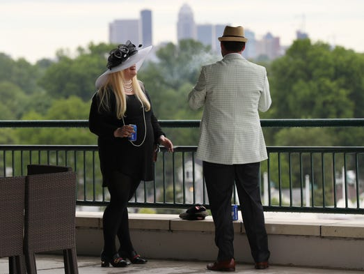 A balcony at Churchill Downs overlooks the city skyline