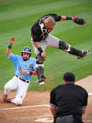 St. Cloud Rox's Ricky Ramirez slides safely around
