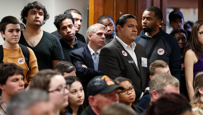 An overflow crowd gathers to hear l discussion about House Bill 37 during a meeting of the House Committee on Higher Education Wednesday, Feb. 1, 2017, in Atlanta. Under the bill private colleges that don't cooperate with federal immigration authorities would lose state funding for scholarships and research.