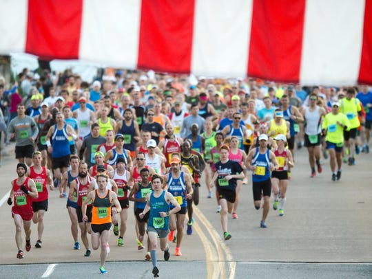 Runners start the Knoxville Marathon on Sunday, April
