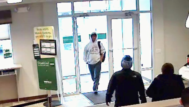 New Castle police are trying to identify this man who they say robbed the WSFS bank branch IN New Castle.