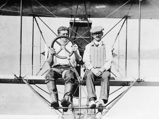 Glenn Curtiss, right, and Theodor Ellyson at the controls of an A1.