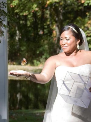 A bride releases a butterfly during her ceremony.