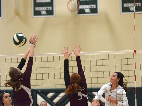 Wilson Memorial's Hannah Johnson spikes the ball past Luray's Ashlee Housden, left, and Courtney Dudley during the first set of their VHSL Region 2B volleyball tournament final on Wednesday, Nov. 8, 2017, at Wilson Memorial High School in Fishersville, Va.
