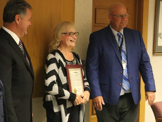 Dorothy Gackstetter, of Graytown, a 2018 inductee of the Ohio Senior Citizens Hall of Fame, laughs with Ottawa County commissioners on Thursday.