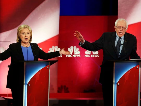 Democratic presidential candidates, former Secretary of State Hillary Clinton, left, and Sen. Bernie Sanders, I-Vt., talk over each other during the Democratic presidential primary debate at the Gaillard Center, Sunday, Jan. 17, 2016, in Charleston, S.C.