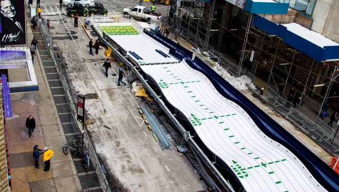 A large slide on Broadway, part of Super Bowl Boulevard activities, is assembled in New York City on Jan. 27. Up to 13 blocks in the heart of Manhattan will be closed to traffic for four days so the NFL can host Super Bowl activities.