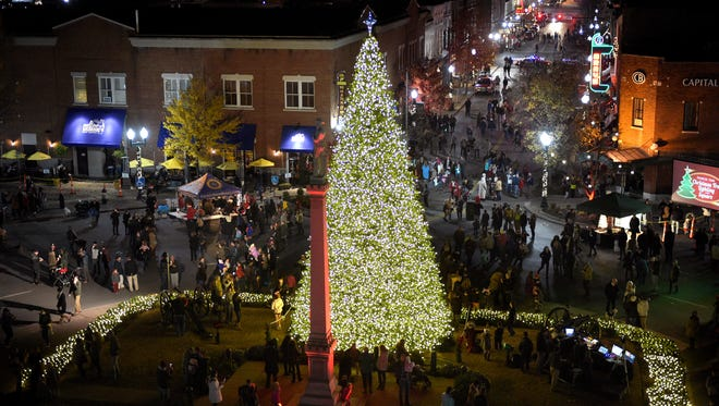 People gather on the Franklin square and Main Street after the City of Franklin?s Christmas tree lighting ceremony Thursday on the downtown Franklin square. From a view in a Middle Tennessee Electric Corp. bucket truck, people gather on the Franklin square and Main Street after the City of Franklin's Christmas tree lighting ceremony on Dec. 1, 2016, on the downtown Franklin square.