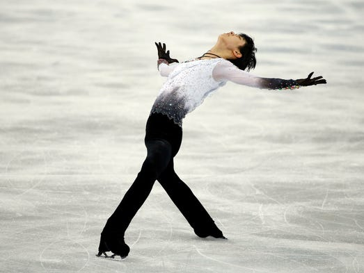Yuzuru Hanyu of Japan performs in the men's free program in figure skating. Hanyu won gold.