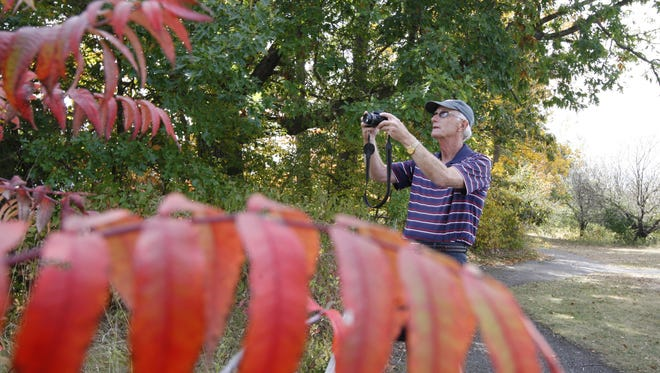A file photo of Ray Engman, from Kane, Pennsylvania, taking photos at Letchworth State Park in 2013.
