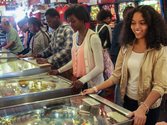 (L-R) Dorvens Alexis, Trisha Smith and Tiarra Poole, all of Asbury Park,  play games at Silverball Pinball Museum on the Asbury Park boardwalk.