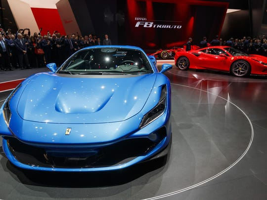 Visitors look at the new Ferrari F8 Tributo during the press day Tuesday at the 89th Geneva International Motor Show in Switzerland.