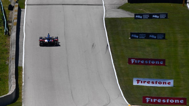 IndyCar Series driver Takuma Sato (14) during practice for the Kohler Grand Prix at Road America.