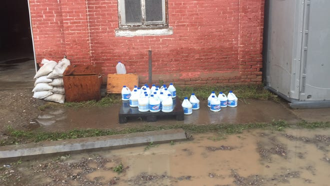 An outside wall of the Sun River Volunteer Fire Department, where the water line reached three feet.