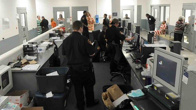 The booking area at the Richland County Jail can be a hectic place.
