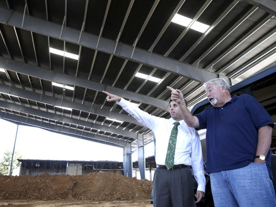 Alex Baker, right, CEO and President of Blackwater Resources, the company that is renovating the newly re-named Centre of Tallahassee shows Jesse Panuccio, the Executive Director of the Florida Department of Economic Opportunity the new amphitheater at the mall on Wednesday.
