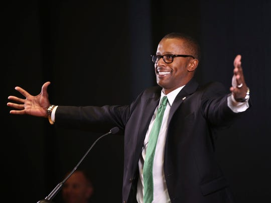 Willie Taggart jokes with the audience during his introductory press conference at Oregon.