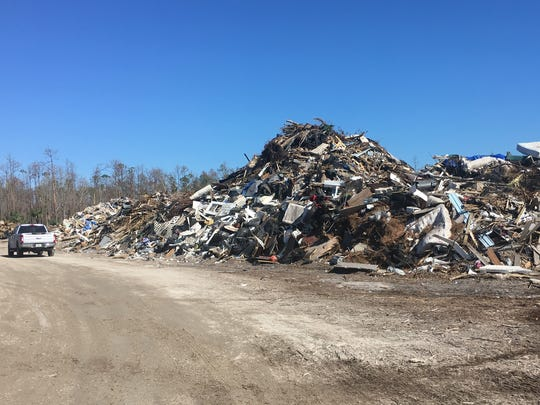 In addition to five massive piles of storm debris, a pile of discarded household items is growing at the county landfill. The material will be hauled off in larger trucks to a landfill near Okeechobee, Fla.