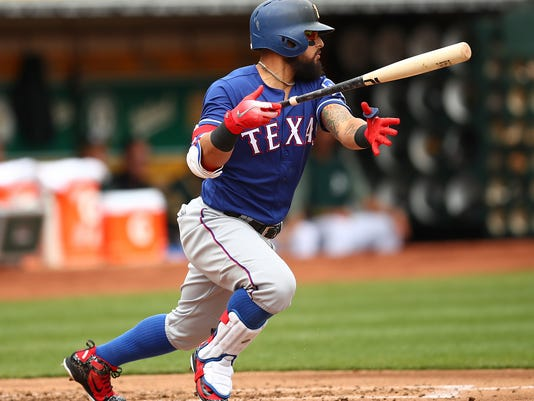 Texas Rangers' Rougned Odor drops his bat after hitting an RBI-single off Oakland Athletics' Daniel Mengden during the second inning of a baseball game Thursday, April 5, 2018, in Oakland, Calif. (AP Photo/Ben Margot)