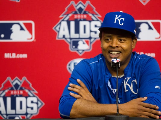 Kansas City Royals pitcher Edinson Volquez speaks during a news conference for baseball's American League Division Series, Saturday, Oct. 10, 2015, in Houston. The Houston Astros host the Royals in Game 3 on Sunday. The best-of-five games series is tied 1-1.  (AP Photo/Patric Schneider)