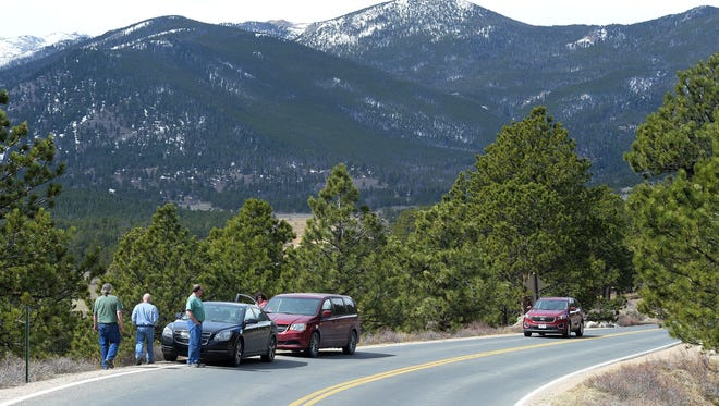 Valerie Mosley/The Coloradoan Visitors stop to view a large herd of elk at Rocky Mountain National Park on March 23. Visitors stop to view a large herd of elk at Rocky Mountain National Park on Thursday, March 23, 2017.