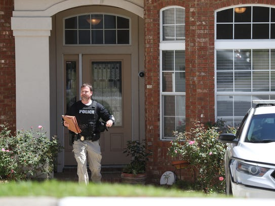 The FBI and local police remove items from a home owned by a family member of white nationalist Jordan Jereb.