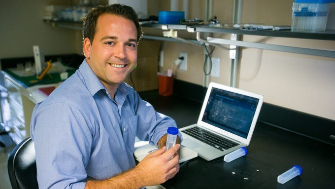 """Co-Founder/CEO Garrett Cale Smith sits in the lab at his office in Peoria on Tuesday, October 29, 2013. Smith was recognized in the 2013 class of """"35 Entrepreneurs 35 and Younger"""""""